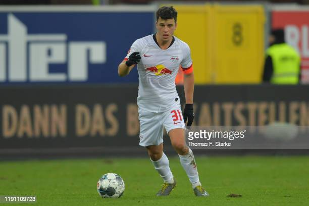 Diego Demme of Leipzig runs with the ball during the Bundesliga match between SC Paderborn 07 and RB Leipzig at Benteler Arena on November 30, 2019...