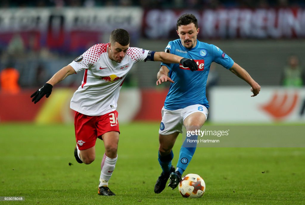 Diego Demme (L) of Leipzig vies with Mario Rui (R) of Napoli during the UEFA Europa League Round of 32 match between RB Leipzig and Napoli at the Red Bull Arena on February 22, 2018 in Leipzig, Germany.