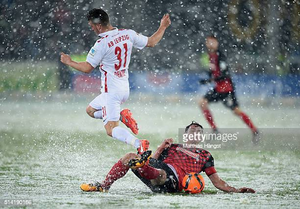 Diego Demme of RB Leipzig and Nicolas Hoefler of Freiburg compete for the ball during the Second Bundesliga match between SC Freiburg and RB Leipzig...