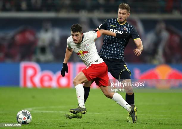 Diego Demme of RB Leipzig battles for possession with Simon Terodde of 1. FC Koeln during the Bundesliga match between RB Leipzig and 1. FC Koeln at...