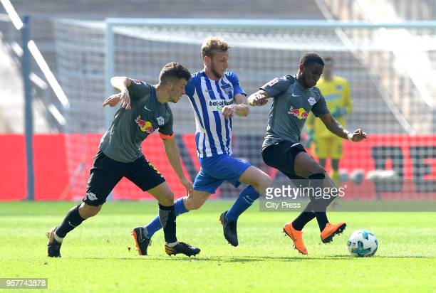 Diego Demme of RB Leipzig Fabian Lustenberger of Hertha BSC and Ademola Lookman of RB Leipzig during the Bundesliga game between Hertha BSC and RB...
