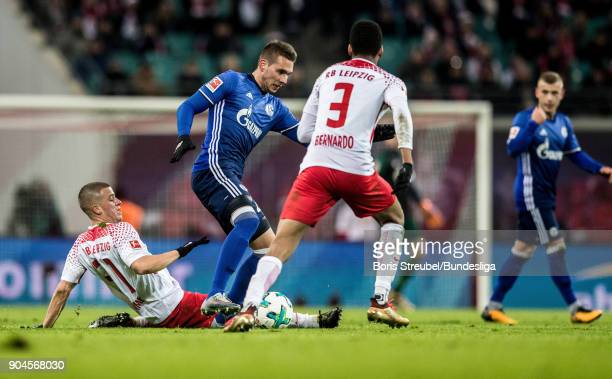 Diego Demme of RB Leipzig in action with Marko Pjaca of FC Schalke 04 during the Bundesliga match between RB Leipzig and FC Schalke 04 at Red Bull...