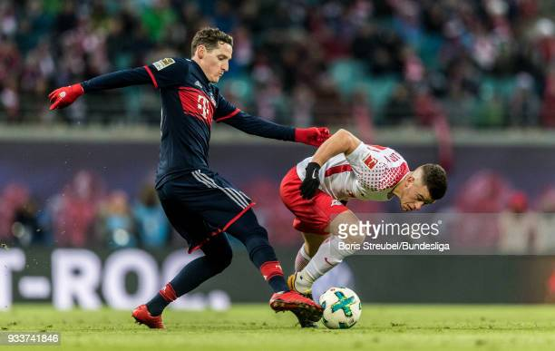 Diego Demme of RB Leipzig in action with Sebastian Rudy of FC Bayern Muenchen during the Bundesliga match between RB Leipzig and FC Bayern Muenchen...