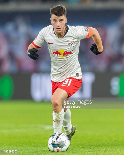 Diego Demme of RB Leipzig runs with the ball during the Bundesliga match between RB Leipzig and FC Augsburg at Red Bull Arena on December 21, 2019 in...