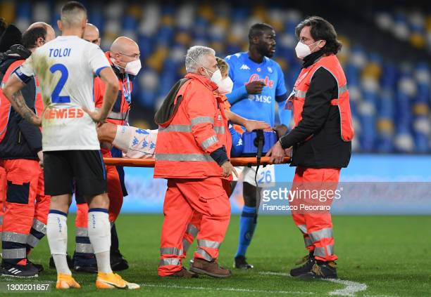 Diego Demme of SSC Napoli is stretchered off of the pitch by medic's during the Coppa Italia match between SSC Napoli and Atalanta BC at Stadio Diego...