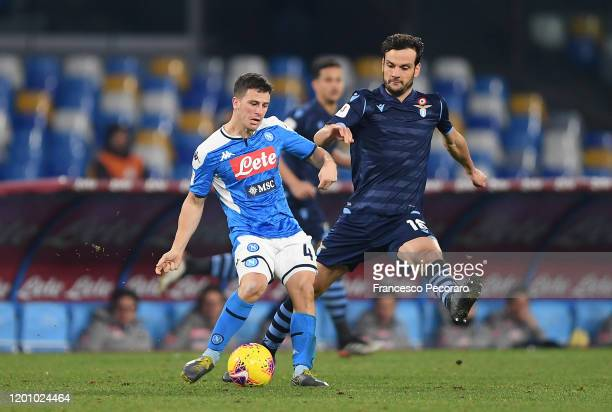Diego Demme of SSC Napoli vies for the ball with Marco Parolo of SS Lazio during the Coppa Italia match between SSC Napoli and SS Lazio at Stadio San...