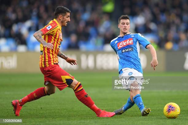 Diego Demme of SSC Napoli vies with Alessandro Deiola of US Lecce during the Serie A match between SSC Napoli and US Lecce at Stadio San Paolo on...