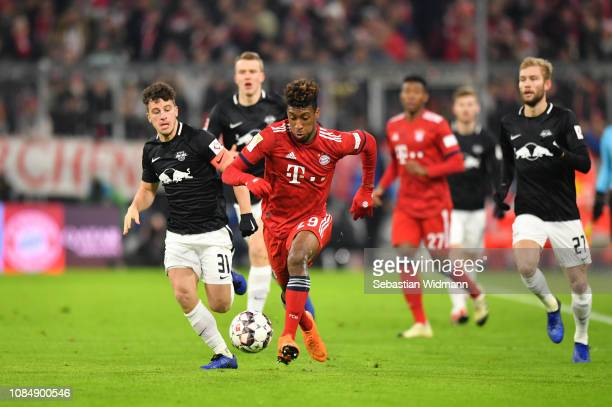 Diego Demme of Leipzig and Kingsley Coman of Bayern Munich compete for the ball during the Bundesliga match between FC Bayern Muenchen and RB Leipzig...