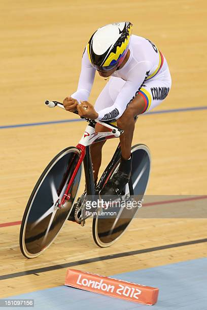 Diego Duenas Gomez of Columbia competes in the Men's Individual Cycling C4 Pursuit qualification on day 3 of the London 2012 Paralympic Games at...