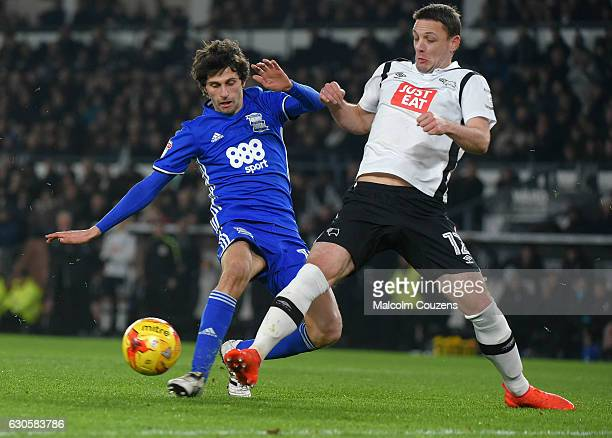 Diego Fabbrini of Birmingham City competes with Chris Baird of Derby County during the Sky Bet Championship match between Derby County and Birmingham...
