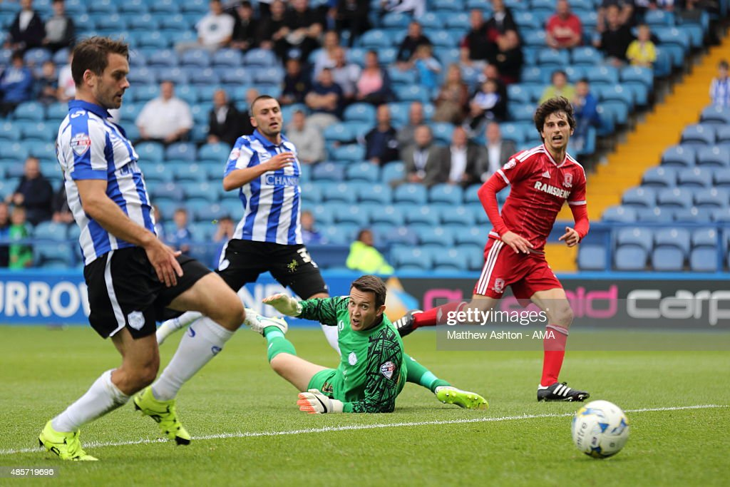 Diego Fabbrini of Middlesbrough scores a goal to make it 1-2 past goalkeeper Lewis Price of Sheffield Wednesday during the Sky Bet Championship match between Sheffield Wednesday and Middlesbrough at Hillsborough on August 29, 2015 in Sheffield, England.
