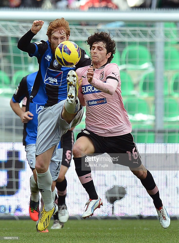 Diego Fabbrini (R) of Palermo and Davide Biondini of Atalanta compete for the ball during the Serie A match between US Citta di Palermo and Atalanta BC at Stadio Renzo Barbera on February 3, 2013 in Palermo, Italy.