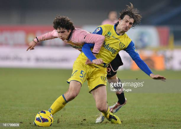 Diego Fabbrini of Palermo and Francesco Acerbi of Chievo Verona compete for the ball during the Serie A match between AC Chievo Verona and US Citta...