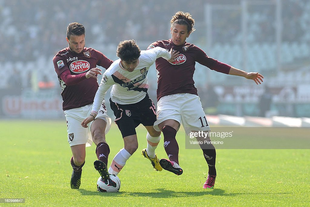 Diego Fabbrini (C) of US Citta di Palermo is tackled by Matteo Brighi (L) and Alessio Cerci of Torino FC during the Serie A match between Torino FC and US Citta di Palermo at Stadio Olimpico di Torino on March 3, 2013 in Turin, Italy.