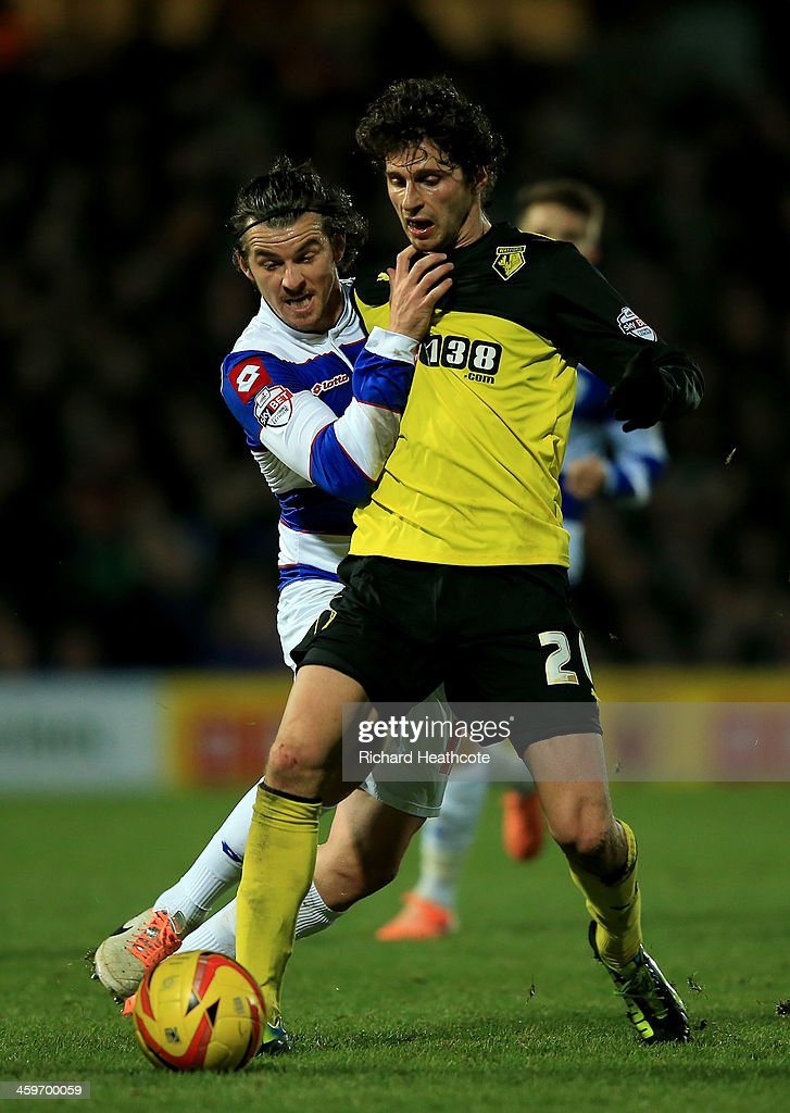 Diego Fabbrini of Watford is tackled by Joey Barton of QPR during the Sky Bet Championship match between Watford and Queens Park Rangers at Vicarage Road on December 29, 2013 in Watford, England,