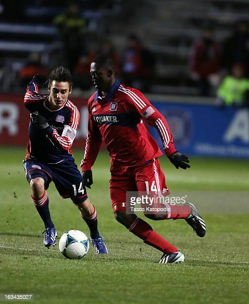 Diego Fagundez of New England Revolution and Patrick Nyarko Chicago Fire fight for the ball at Toyota Park March 9 2013 in Bridgeview Illinois