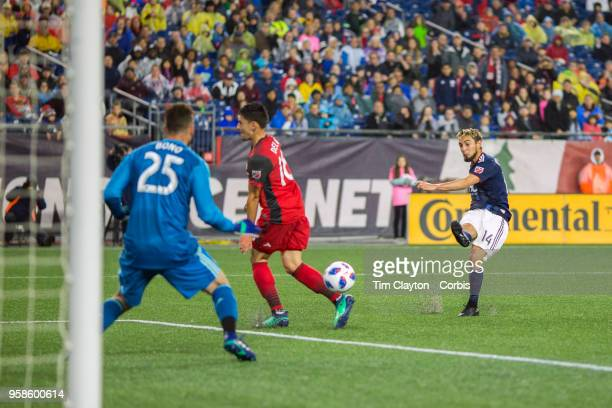 Diego Fagundez of New England Revolution has his shot saved by Alex Bono of Toronto FC during the New England Revolution Vs Toronto FC regular season...