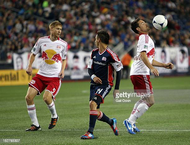 Diego Fagundez of the New England Revolution looks for the ball between Markus Holgersson and Heath Pearce of the New York Red Bulls at Gillette...
