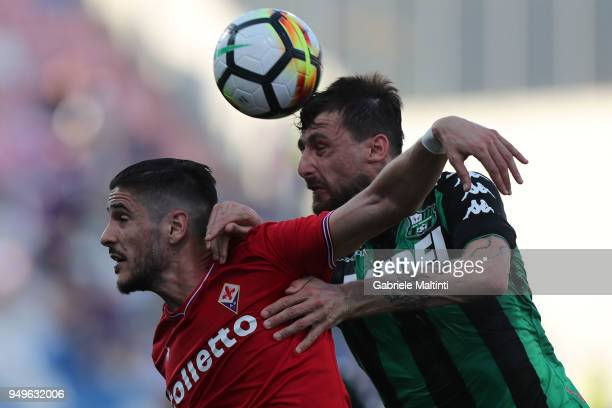 Diego Falcinelli of ACF Fiorentina battles for the ball with Francesco Acerbi of US Sassuolo during the serie A match between US Sassuolo and ACF...