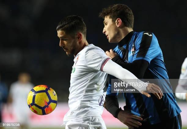 Diego Falcinelli of ACF Fiorentina competes for the ball with Mattia Caldara of Atalanta BC during the serie A match between Atalanta BC and ACF...