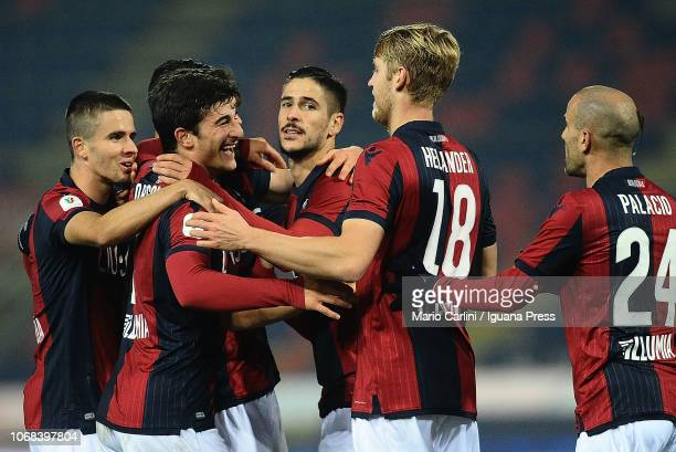 Diego Falcinelli of Bologna FC celebratetes with teammates after scoring his team's second goal during the Coppa Italia match between Bologna FC and...