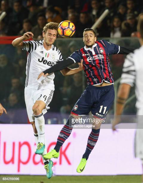 Diego Falcinelli of Crotone competes for the ball in air with Daniele Rugani of Juventus during the Serie A match between FC Crotone and Juventus FC...