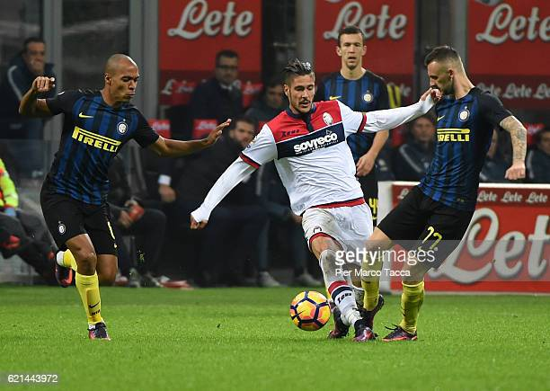 Diego Falcinelli of FC Crotone competes for the ball with Marcelo Brozovic of FC Internazionale during the Serie A match between FC Internazionale...
