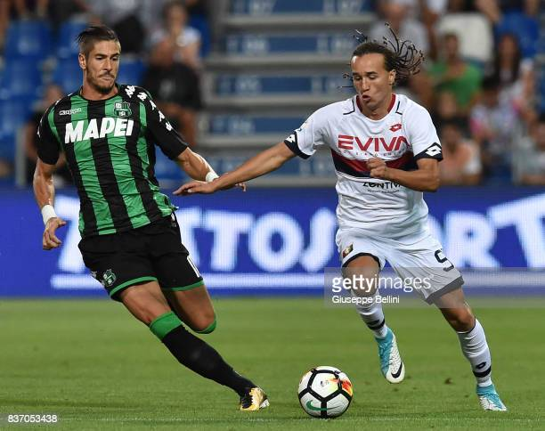 Diego Falcinelli of US Sassuolo and Diego Laxalt of Genoa CFC in action during the Serie A match between US Sassuolo and Genoa CFC at Mapei Stadium...
