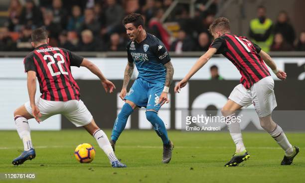 Diego Farias of Empoli FC is challenged by Mateo Musacchio and Andrea Conti of AC Milan during the Serie A match between AC Milan and Empoli at...