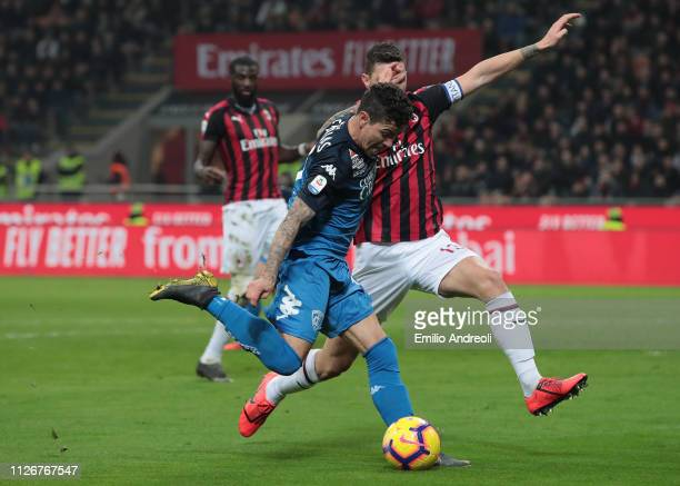Diego Farias of Empoli FC kicks the ball against Alessio Romagnoli of AC Milan during the Serie A match between AC Milan and Empoli at Stadio...