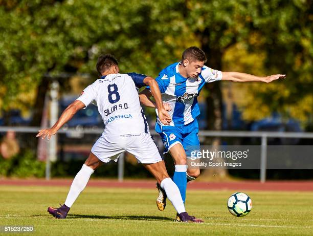 Diego Fernandez of Club Silva SD competes for the ball with Federico Valverde of Deportivo de La Coruna during the preseason friendly match between...