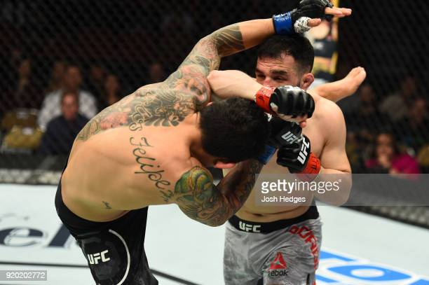Diego Ferreira of Brazil and Jared Gordon exchange strikes in their lightweight bout during the UFC Fight Night event at Frank Erwin Center on...