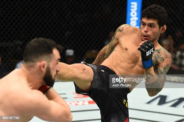 Diego Ferreira of Brazil kicks Jared Gordon in their lightweight bout during the UFC Fight Night event at Frank Erwin Center on February 18 2018 in...