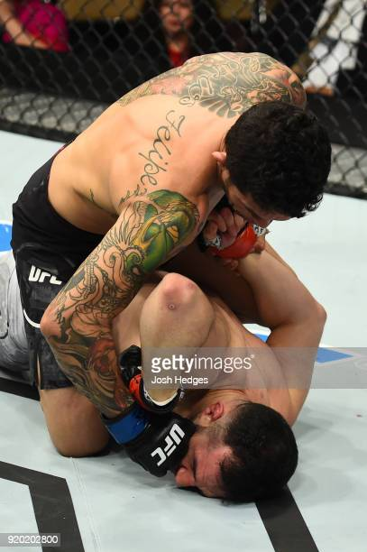 Diego Ferreira of Brazil punches Diego Ferreira of Brazil in their lightweight bout during the UFC Fight Night event at Frank Erwin Center on...