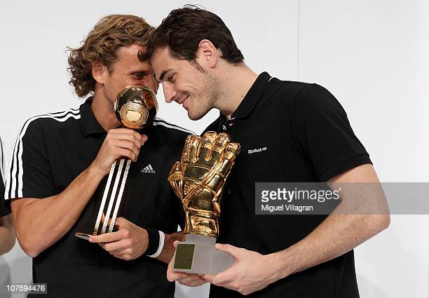 Diego Forlan adidas Golden Ball Winner and Iker Casillas adidas Golden Glove Winner pose with their FIFA 2010 World Cup adidas Golden Awards during...