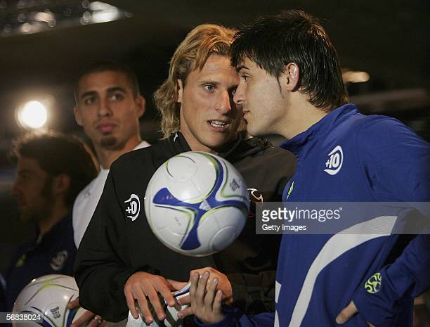 Diego Forlan and David Villa talk during the Major adidas F50 Tunit Launch Event on February 13 2006 in Munich