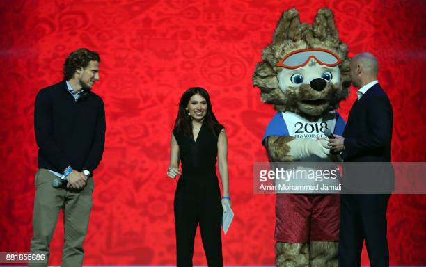Diego Forlan and Maria Komandnaya on stage with the 2018 World Cup mascot during the Behind the Scenes of the Final Draw for the 2018 FIFA World Cup...