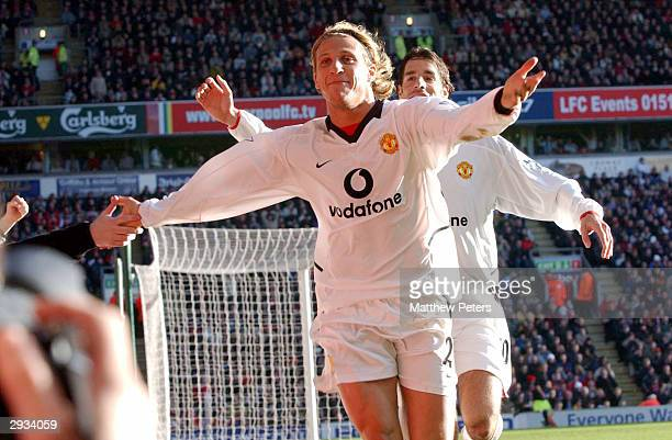 Diego Forlan celebrates his first goal of the match with Ruud Van Nistelrooy during the FA Barclaycard Premiership match between Liverpool v...
