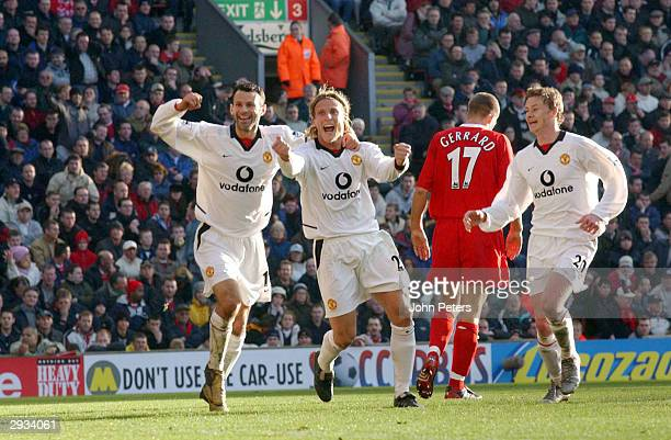 Diego Forlan celebrates his second goal of the match with Ryan Giggs and Ole Gunnar Solkjaer during the FA Barclaycard Premiership match between...