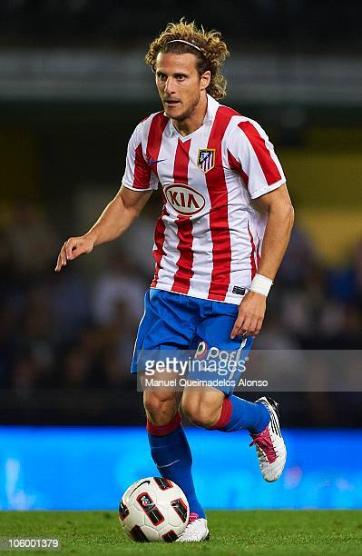Diego Forlan of Atletico de Madrid in action during the La Liga match between Villarreal and Atletico de Madrid at El Madrigal on October 24 2010 in...