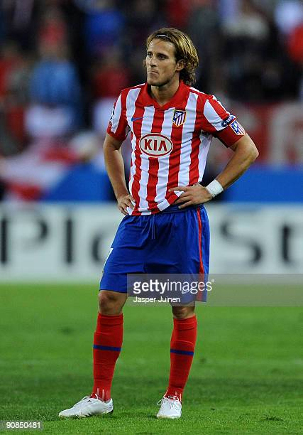 Diego Forlan of Atletico de Madrid stands dejected during the Champions League group D match between Atletico Madrid and APOEL FC at the Vicente...