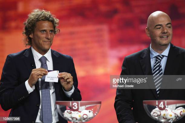 Diego Forlan of Atletico Madrid and Uruguay alongside UEFA General Secretary Gianni Infantino during the UEFA Europa League Group Stage Draw at the...