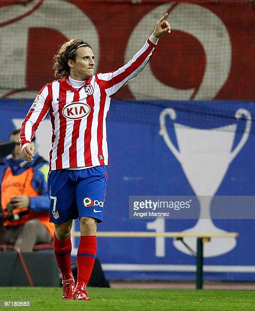 Diego Forlan of Atletico Madrid celebrates after scoring during the La Liga match between Atletico Madrid and Valencia at Vicente Calderon Stadium on...