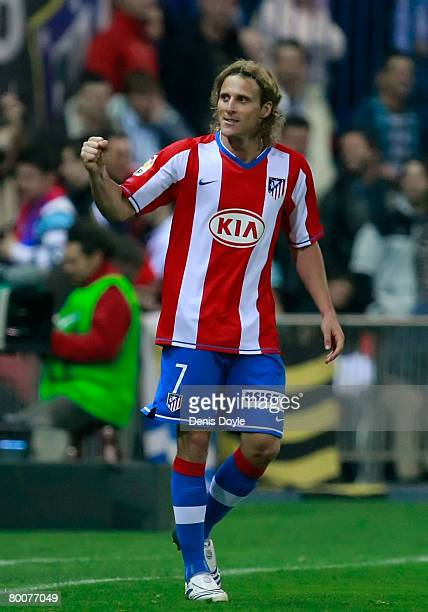Diego Forlan of Atletico Madrid celebrates after scoring his team's fourth goal during the La Liga match between Atletico Madrid and Barcelona at the...