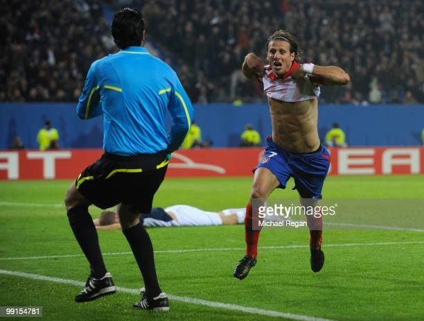 Diego Forlan of Atletico Madrid celebrates after scoring his team's second goal in extra time during the UEFA Europa League final match between...