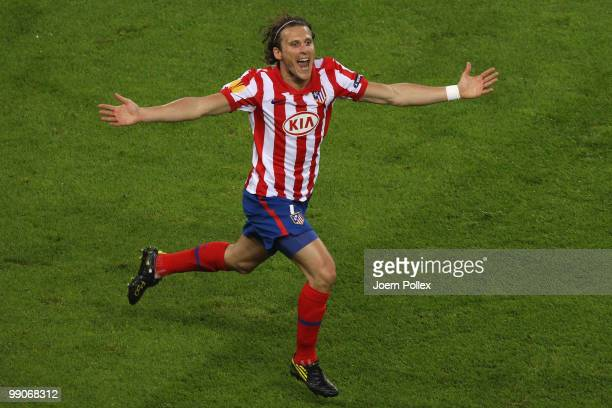 Diego Forlan of Atletico Madrid celebrates after scoring the opening goal during the UEFA Europa League final match between Atletico Madrid and...