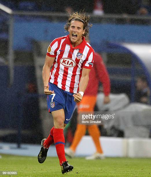Diego Forlan of Atletico Madrid celebrates the first goal during the UEFA Europa League final match between Atletico Madrid and Fulham at HSH...