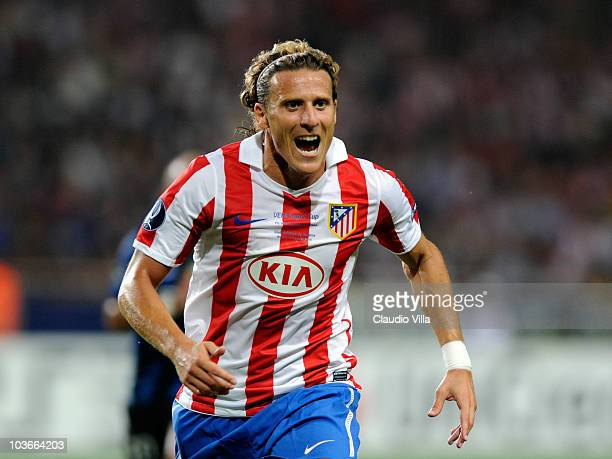 Diego Forlan of Atletico Madrid competes for the ball during the UEFA Super Cup between Inter and Atletico Madrid at Louis II Stadium on August 27...