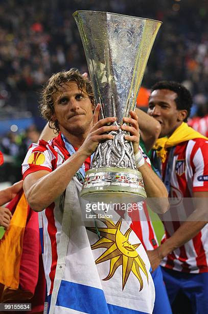 Diego Forlan of Atletico Madrid holds the UEFA Europa League trophy following his team's victory after extra time at the end of the UEFA Europa...