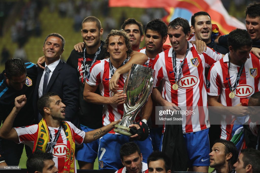 Diego Forlan of Atletico Madrid hugs the Super Cup after his sides 2-0 victory during the UEFA Super Cup match between Inter Milan and Atletico Madrid at Louis II Stadium on August 27, 2010 in Monaco, Monaco.